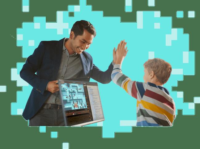 Man high-fiving kid playing CodeCombat